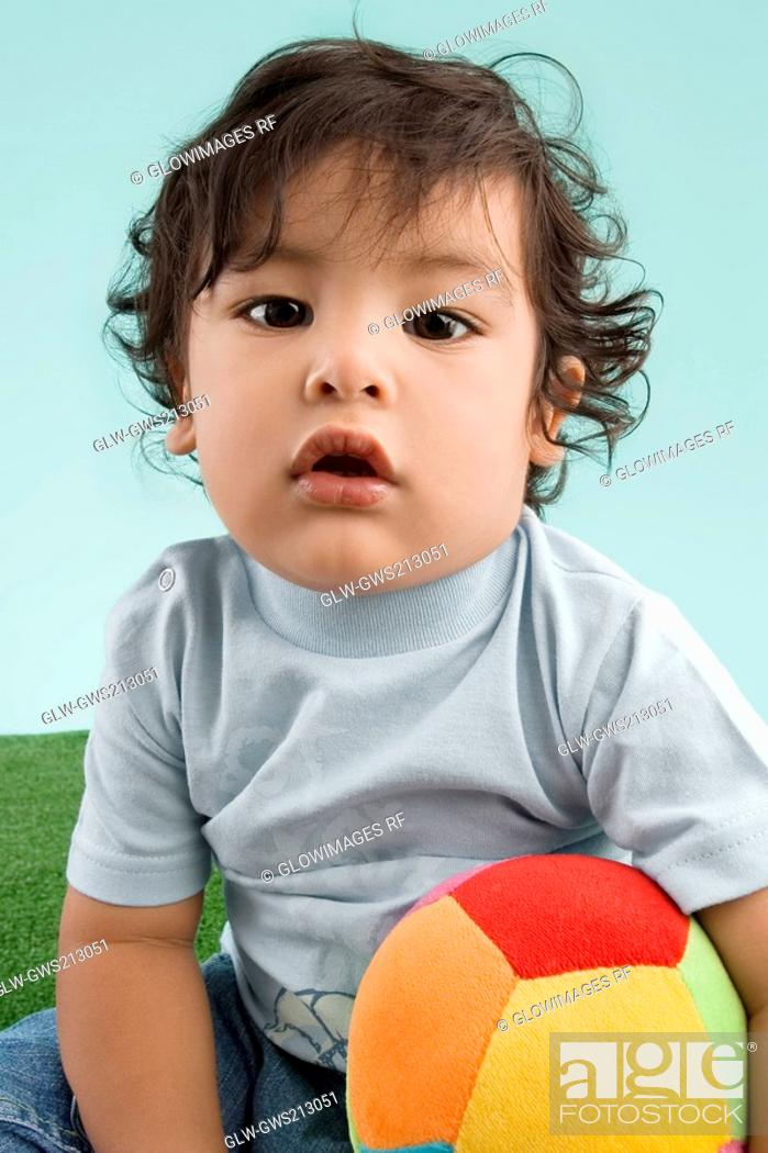 Stock Photo: Portrait of a boy playing with a ball.