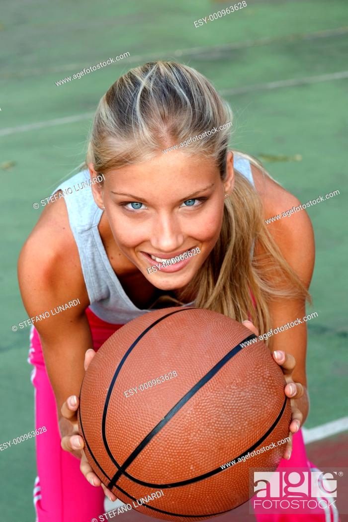 Stock Photo: Teenage girl ready to pass the ball.