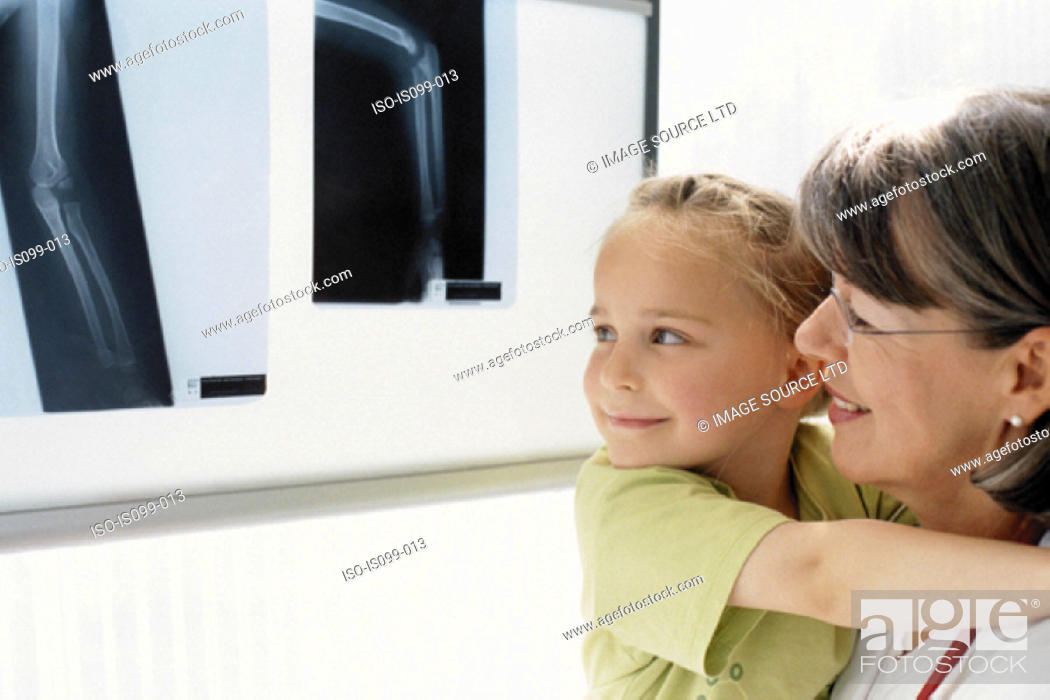Stock Photo: Girl and mother examining x-ray.