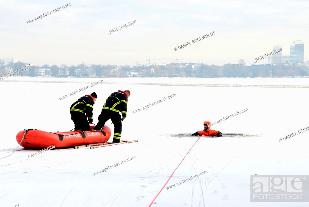 Stock Photo: Firefighters conduct a drill in which they rescue a woman who broke through the ice of the Alster in Hamburg, Germany, 25 January 2013.