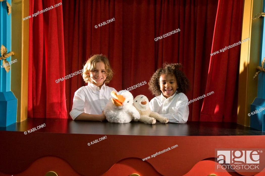 Stock Photo: Portrait of school kids performing with animal puppets.