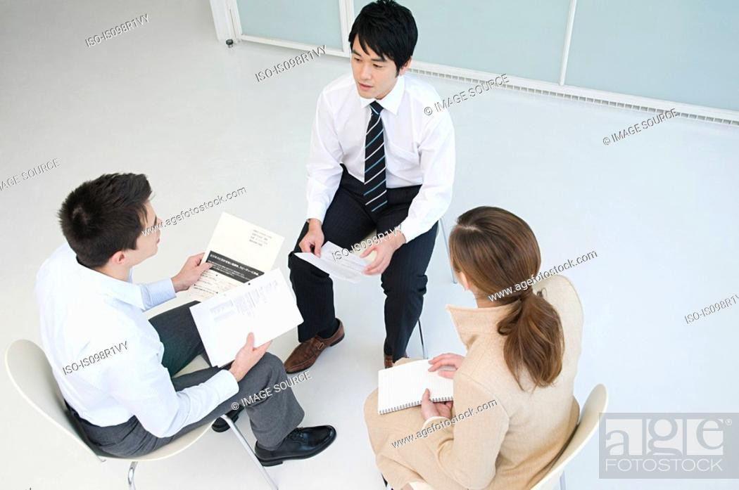 Stock Photo: Elevated view of businesspeople having a meeting.