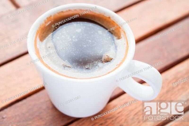 Stock Photo: Refreshing drink with a cup of hot espresso.