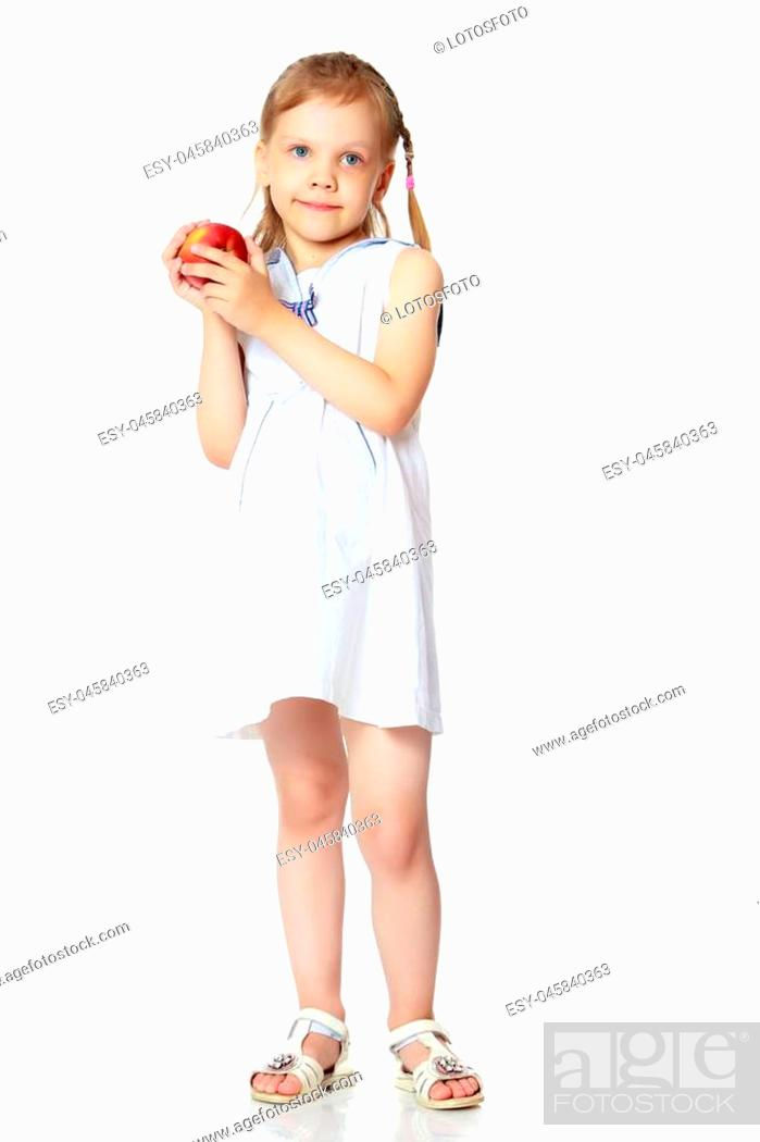 Stock Photo: Little girl with an apple. Concept of healthy eating, happiness, Happy childhood, harvesting. Isolated on white background.