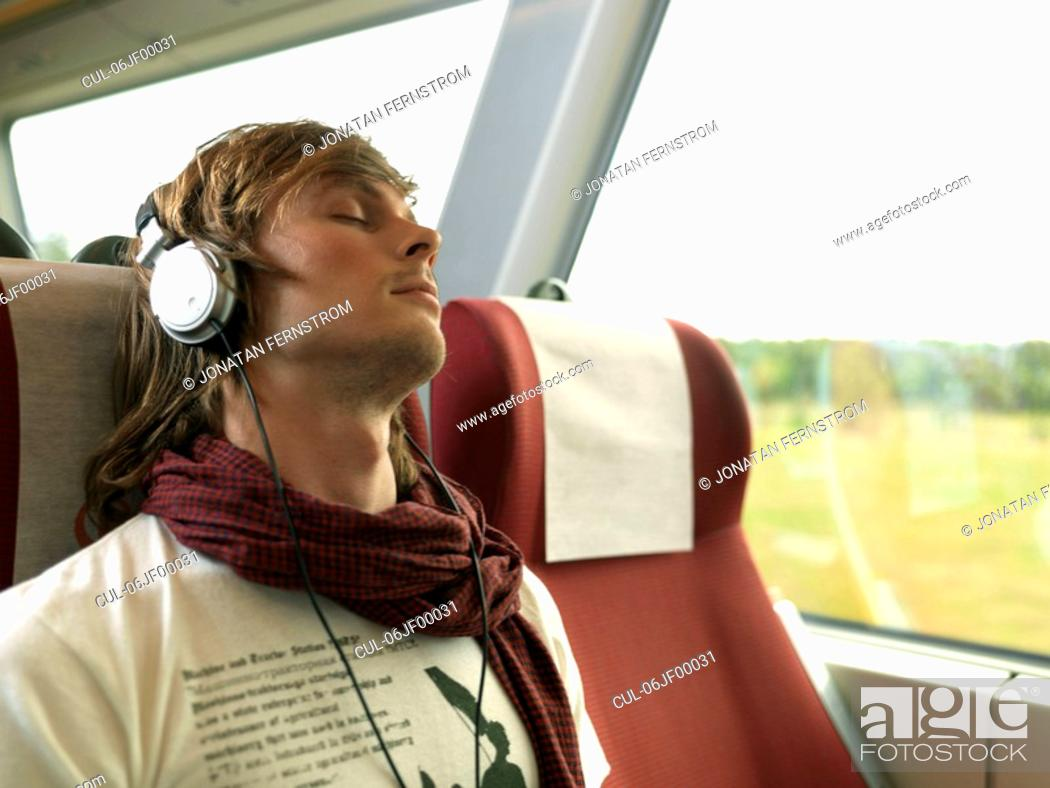 Stock Photo: Young man on train.