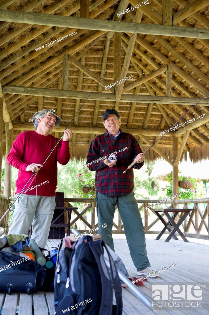 Stock Photo: Hispanic friends preparing to go fishing.