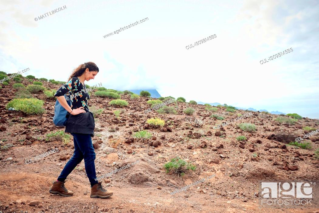 Stock Photo: Woman hiking on dirt track in arid landscape, Las Palmas, Gran Canaria, Canary Islands, Spain.