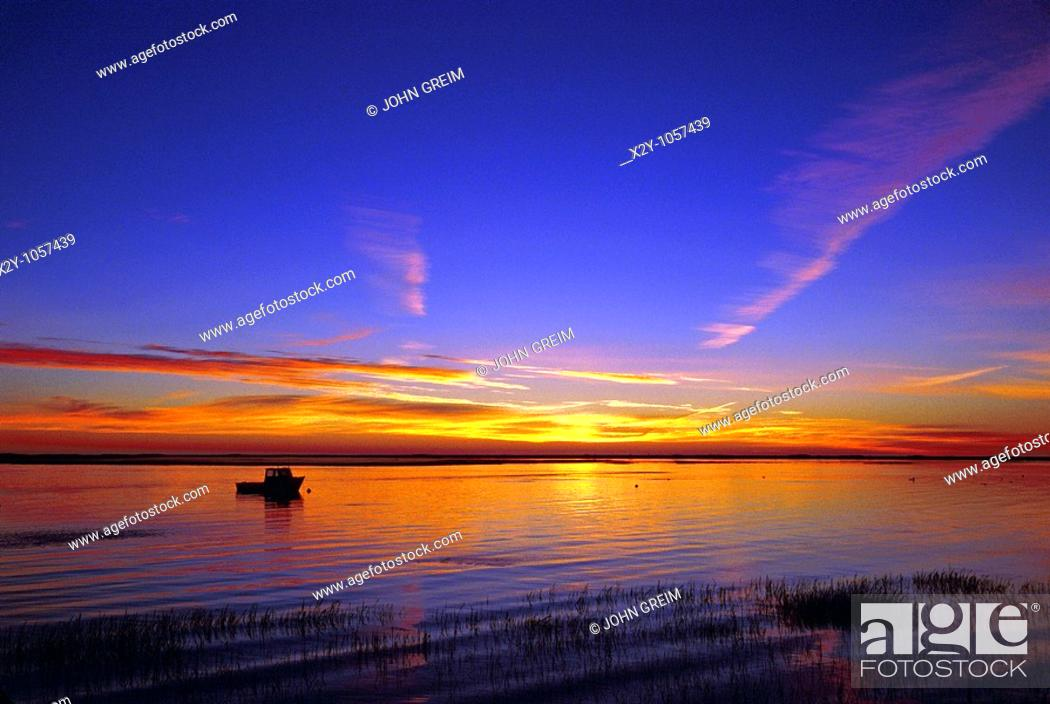 Stock Photo: Silhouette of a lobster boat in harbor, Nauset Harbor, East Orleans, Cape Cod, Massachusettes.