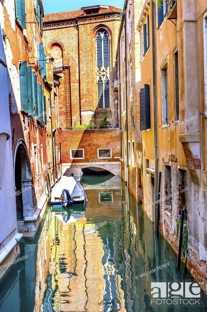 Stock Photo: Motor Boat Colorful Small Side Canal Church Buildings Reflections Venice Italy.