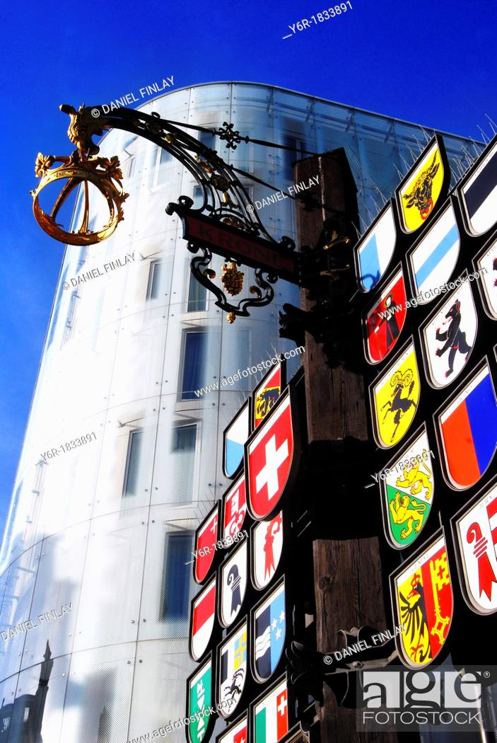 Stock Photo: View in Leicester Square in the heart of London, England, of the avant garde W hotel and a display of the coats-of-arms of Swiss cantons remaining from the time.