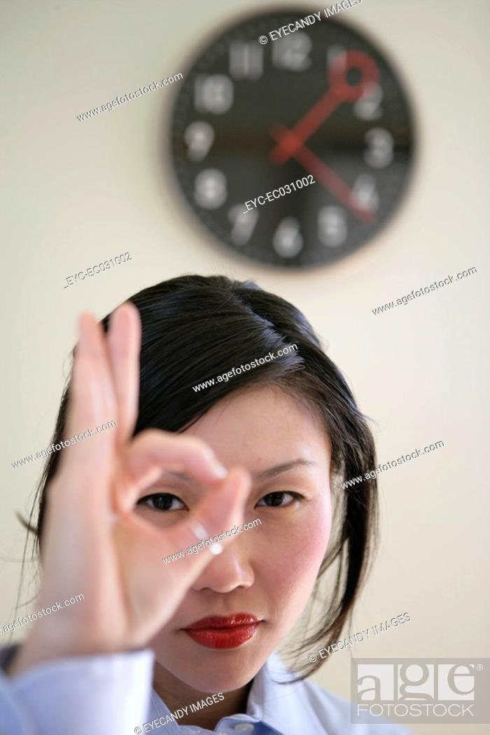 Stock Photo: Young woman gesturing, close-up.