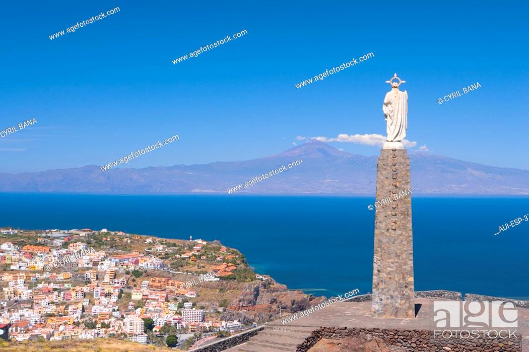 Stock Photo: Spain - Canary Islands - La Gomera - San Sebastian de La Gomera - View of the monument al Sagrado Corazon de Jesus - View of the Island of Tenerife and of the.