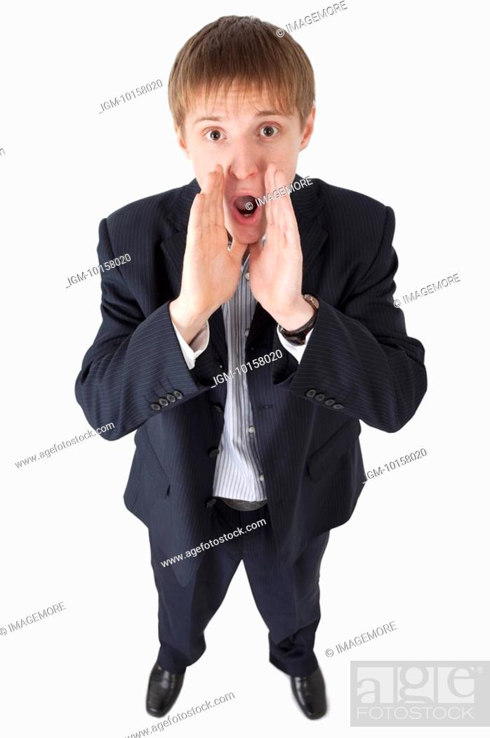 Stock Photo: Young man looking up and shouting with mouth open.