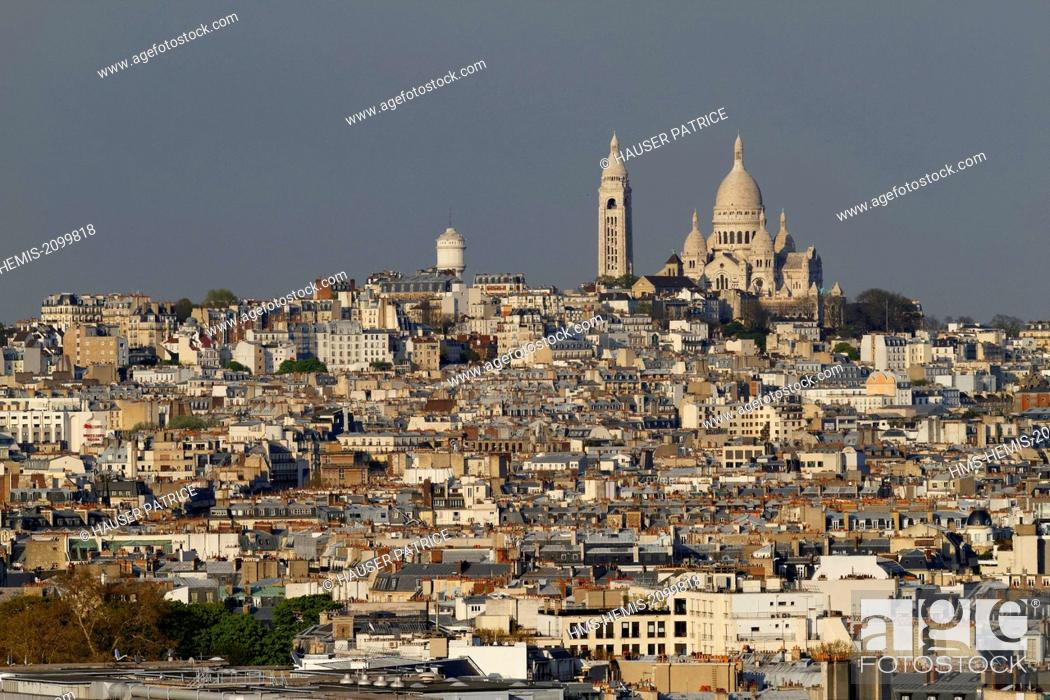 Stock Photo: France, Paris, Sacre Coeur and the hill of Montmartre in background.
