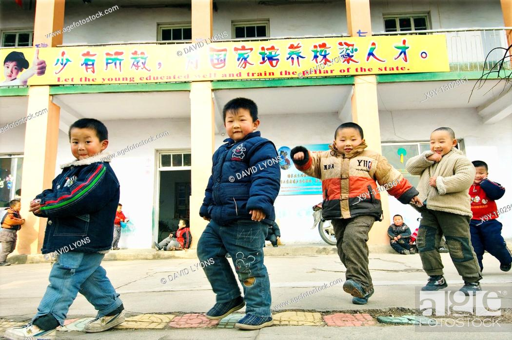 Stock Photo: Chinese children boys in Kindergarten school in rural farm village town of Buyang near Jinan city in Shandong Province, China.