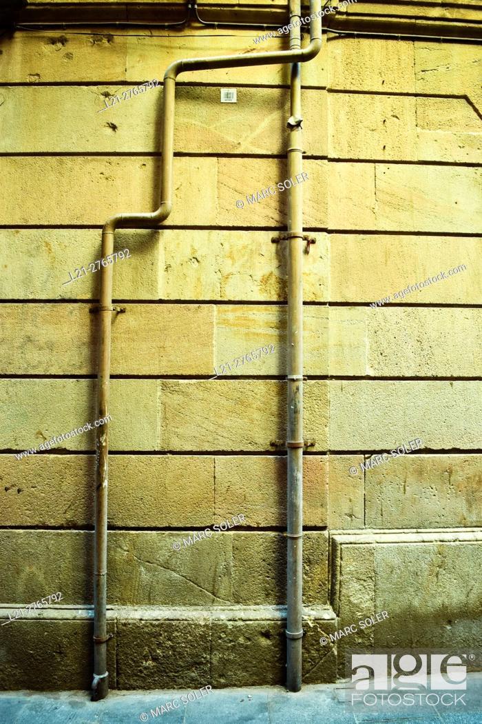 Stock Photo: Pipes on a street wall. Barcelona, Catalonia, Spain.