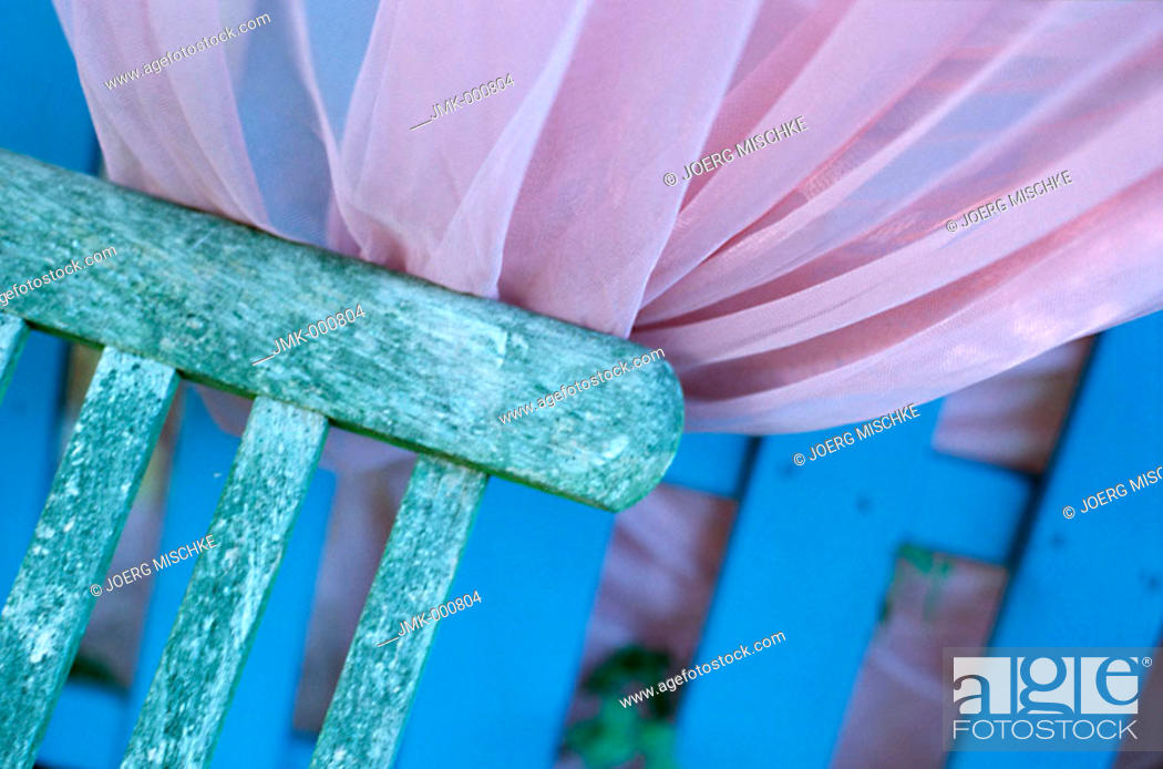 Stock Photo: Deckchair and a mosquito net.