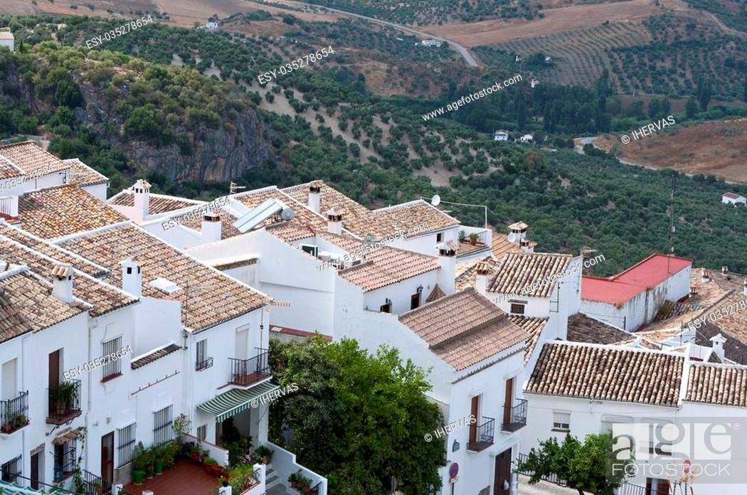 Stock Photo: Traditional White houses in Zahara de la Sierra, Spain. This village is part of the pueblos blancos -white towns- in southern Spain Andalusia region.