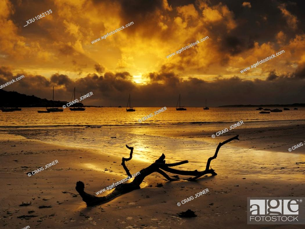 Stock Photo: Sunset over Appledore and the Torridge and Taw estuary viewed from the beach at Instow in Devon, United Kingdom.