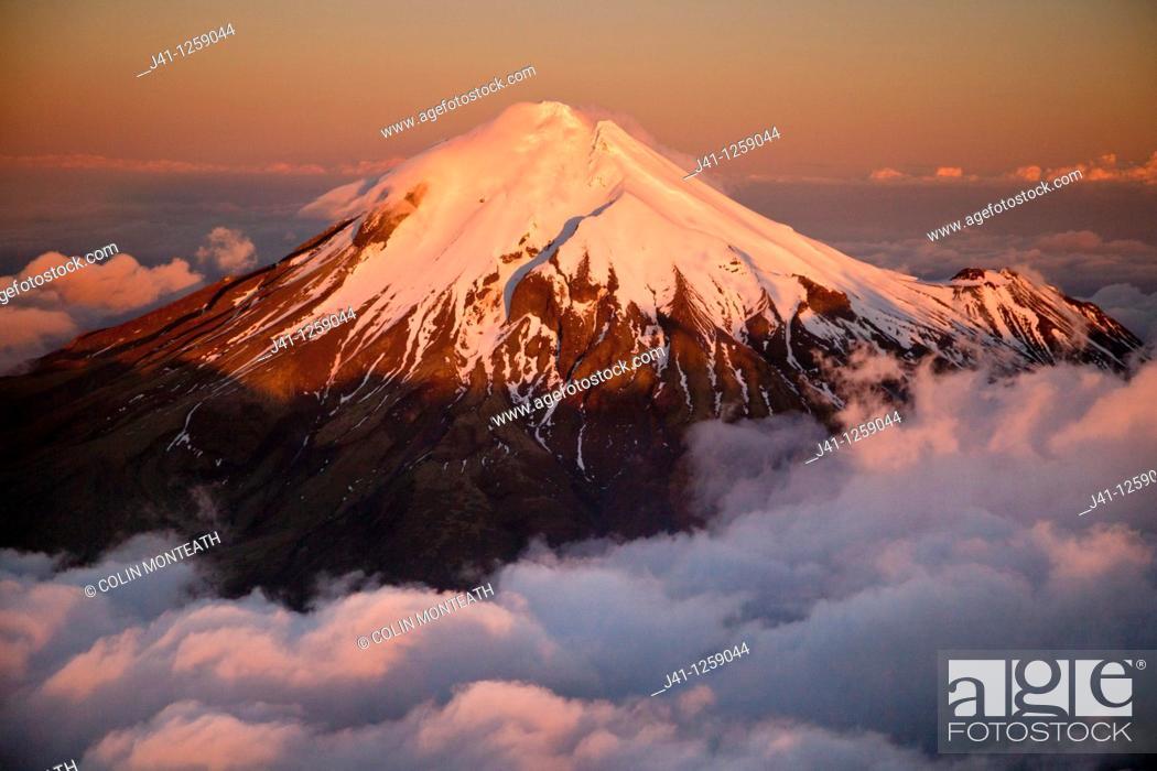 Stock Photo: Mt Egmont / Taranaki, western flanks of dormant volcano above evening cloud, sunset, Taranaki.