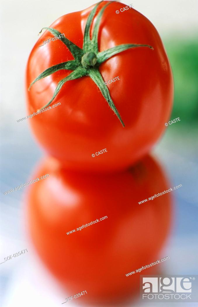Stock Photo: two stacked tomatoes.