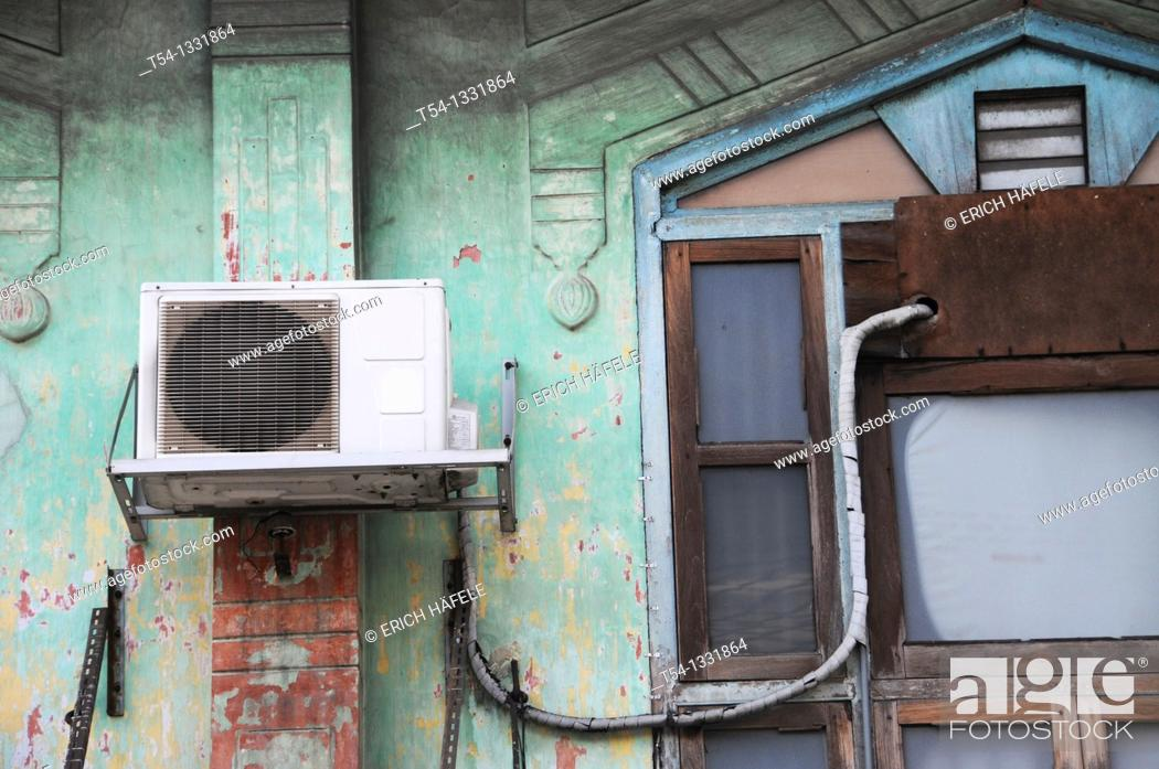 Stock Photo: Air conditioning in a Thai house wall.