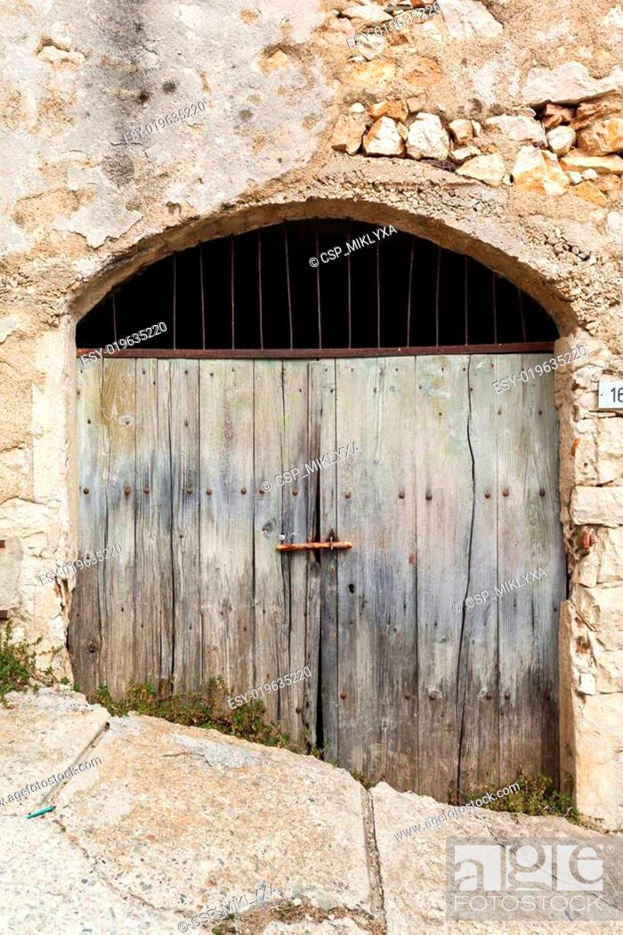 Stock Photo: old vintage green wooden door.
