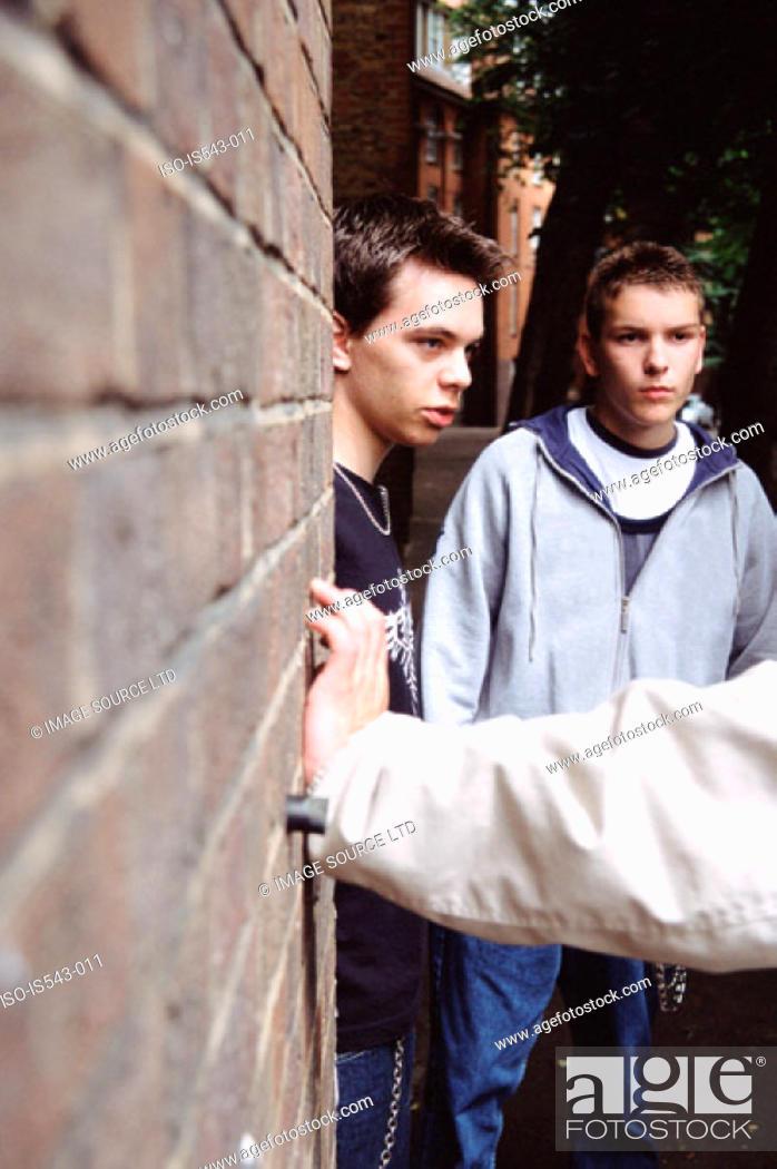 Stock Photo: Teenage boys leaning on wall.