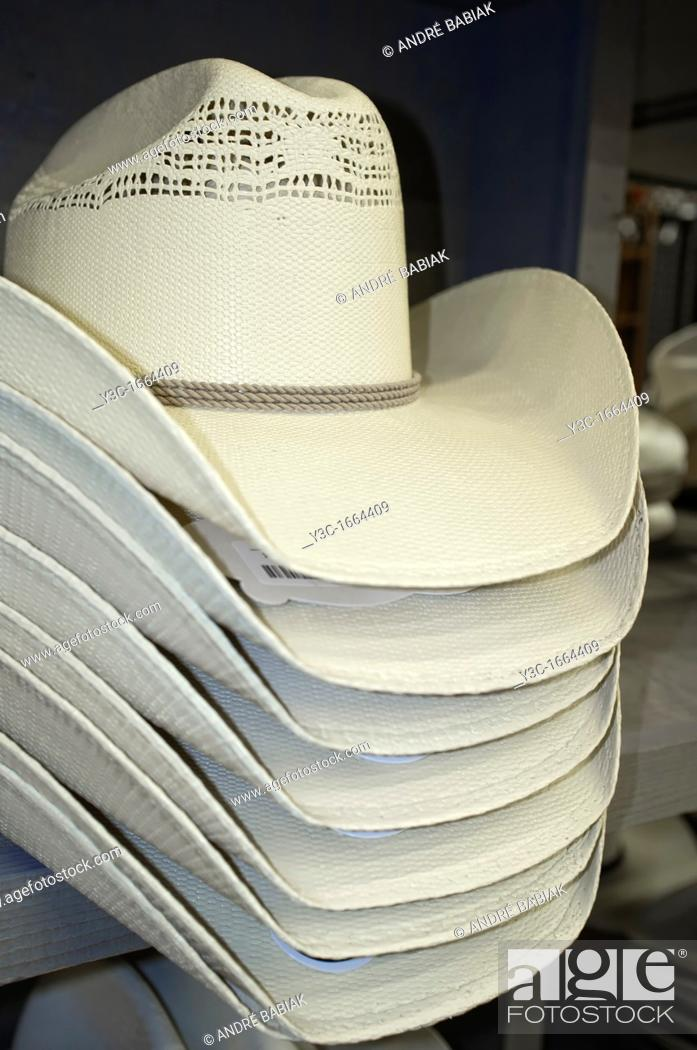 Stock Photo: White cowboy hats on sales display in western outfit shopping center.