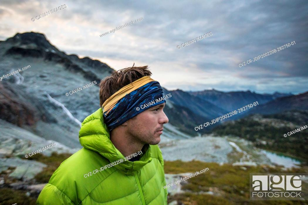 Stock Photo: Side view of climber in the mountains.