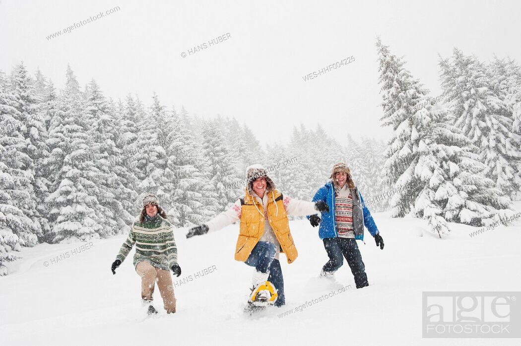 Stock Photo: Austria, Salzburg, Men and woman walking through winter landscape.