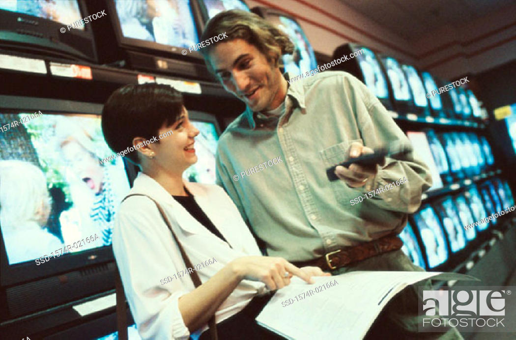 Stock Photo: Young couple shopping for a television.
