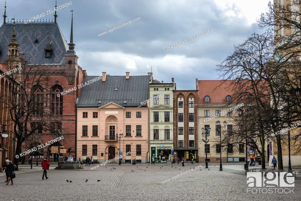 Stock Photo: Tenement houses on the main square of Old Town in Torun, Kuyavian Pomeranian Voivodeship of Poland, Artus Manor on left side.