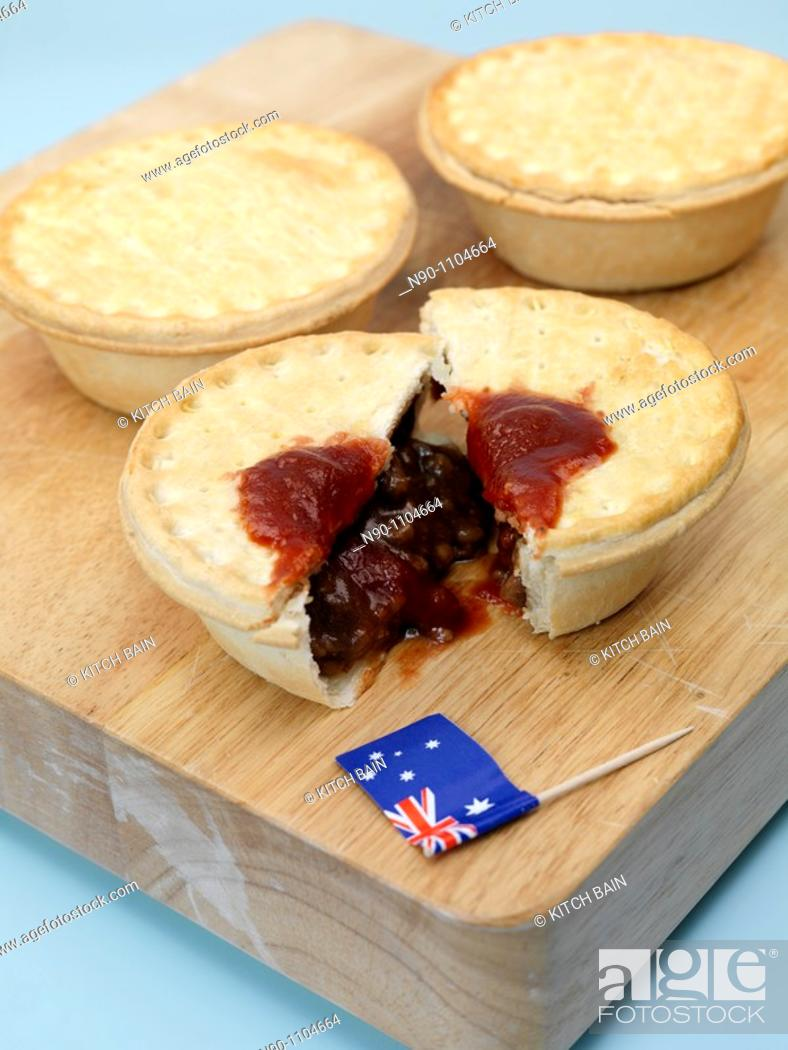 Stock Photo: Australian meat pies on a chopping board.
