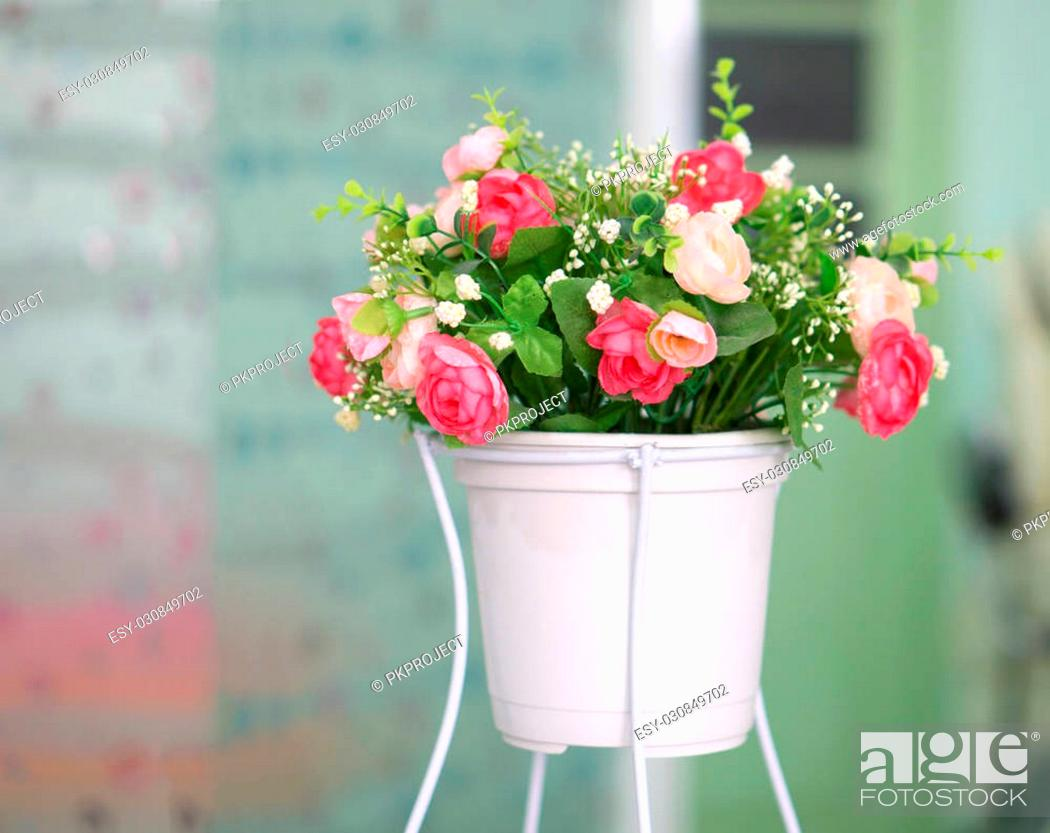 Stock Photo: Colorful decoration artificial flower in white pot.