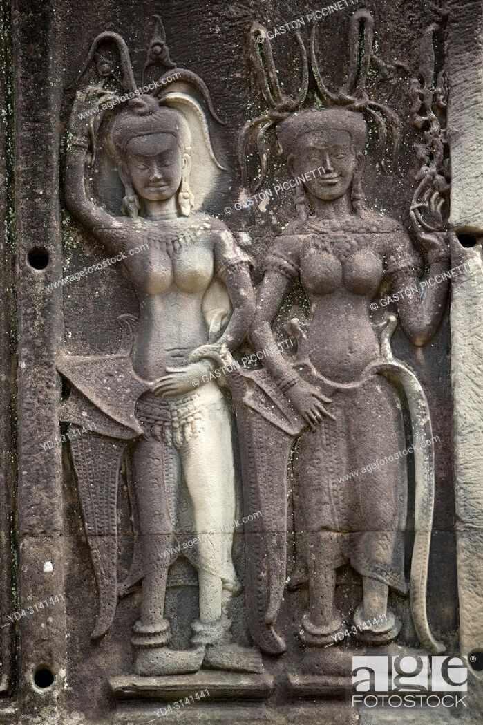 Stock Photo: Relief engravings at Angkor Wat, Siem Reap, Cambodia. It was originally constructed as a Hindu temple dedicated to the god Vishnu for the Khmer Empire.