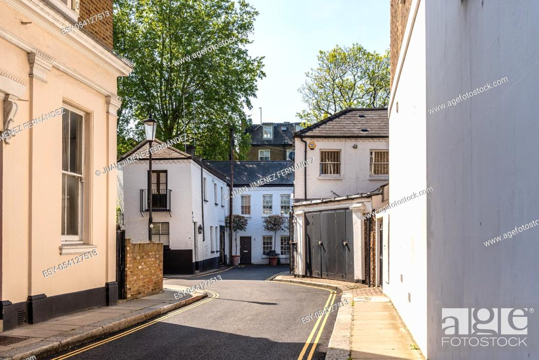 Stock Photo: Townhouses in alley in Notting Hill, a district in West London in the Borough of Kensington and Chelsea, England, UK.