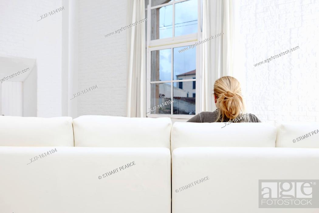 Stock Photo: Woman in living room.