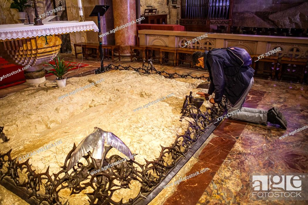 Stone of Agony, man praying,Church of all nations also