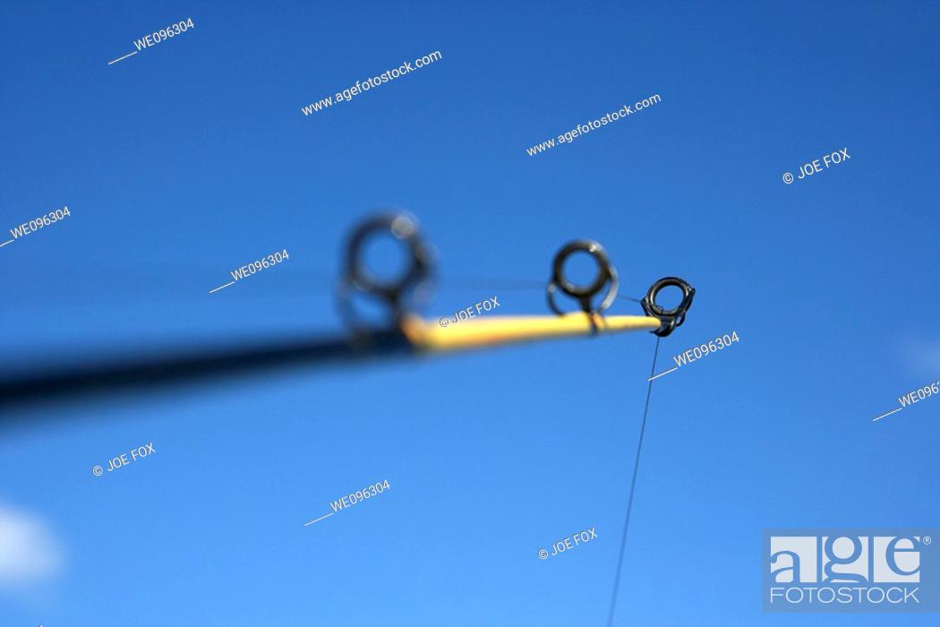Stock Photo: rod and line fishing against blue sky.