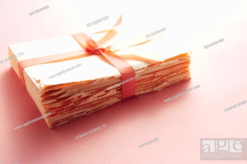 Stock Photo: Letters tied with ribbon.