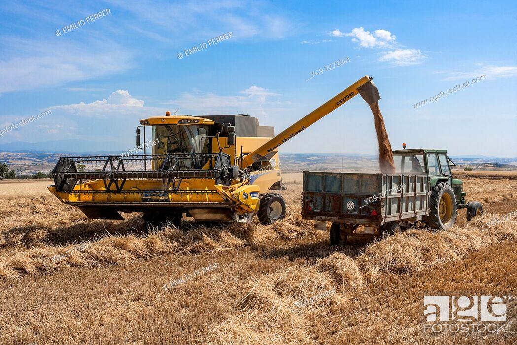 Stock Photo: Combine harvester downloading.