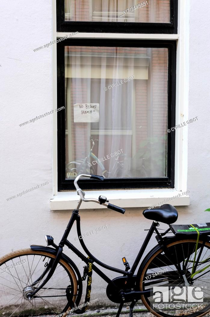 Stock Photo: Bicycle parked by no parking sign, Amsterdam, Netherlands.