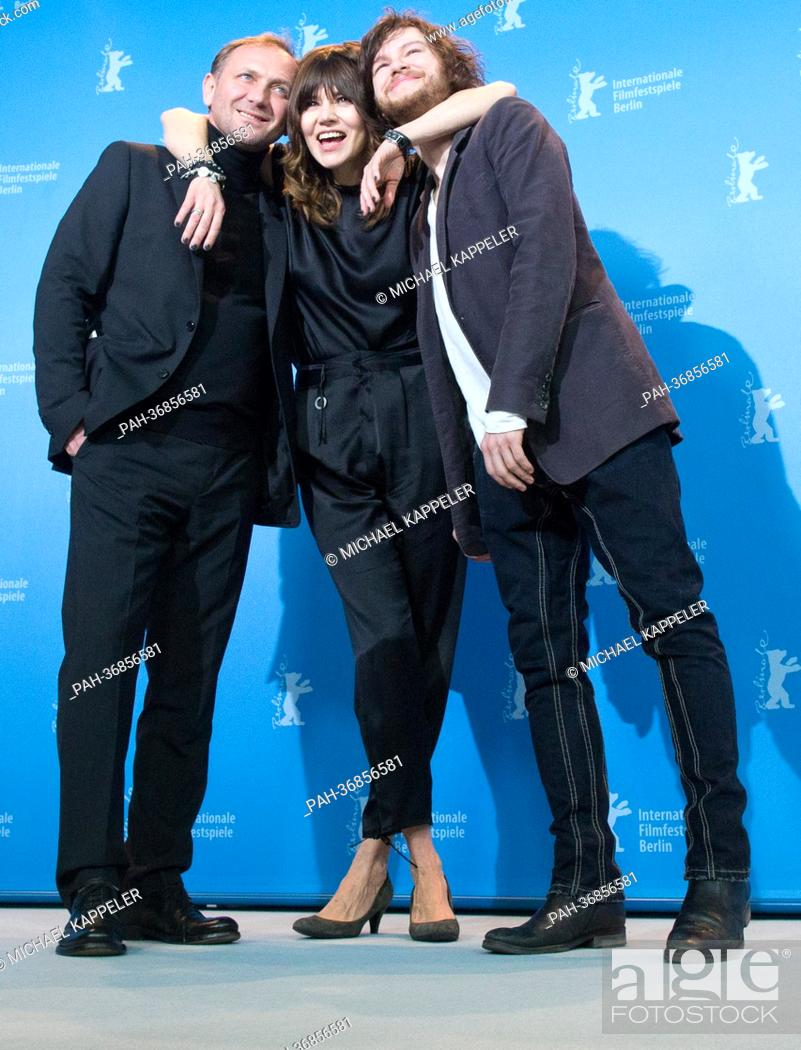 Stock Photo: Director Malgoksa Szumowska of Poland (c) and actors Mateusz Kosciukiewicz (r) and Andrzej Chyra (l) pose at a photocall for «In the name of» (W imie) during.