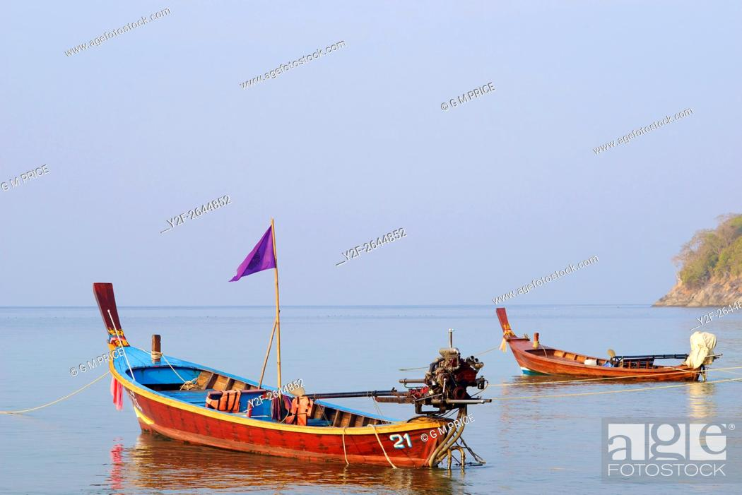 Stock Photo: Thai fishing boats at Kata Beach, Phuket.