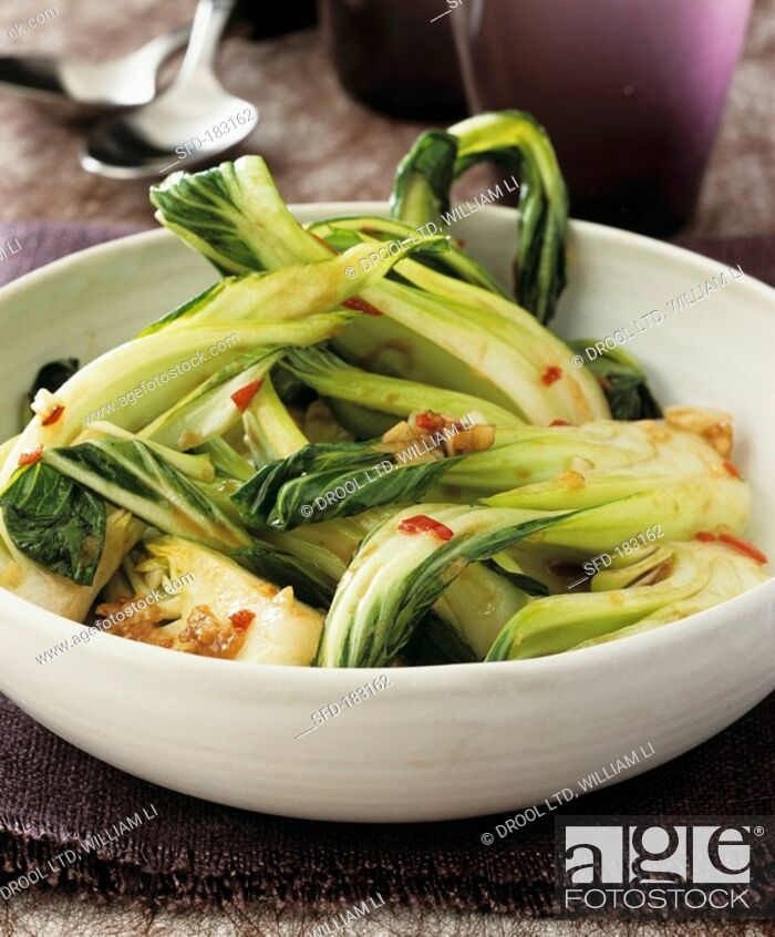 Stock Photo: Pak choi cooked in the wok.