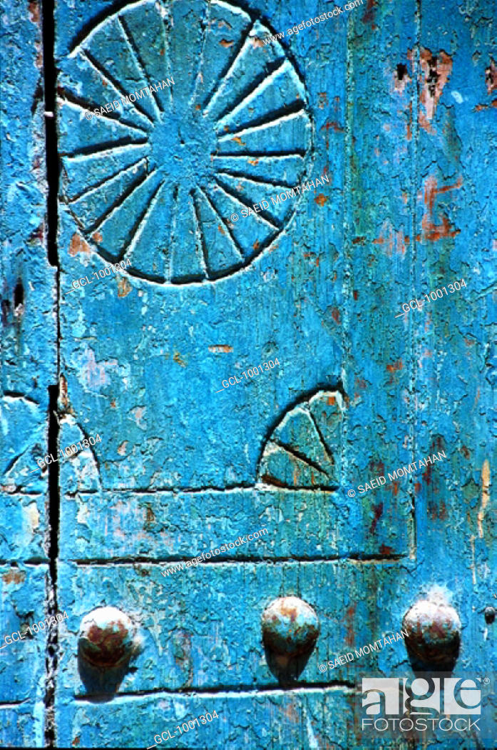 Stock Photo: Ornaments on a blue wooden door.