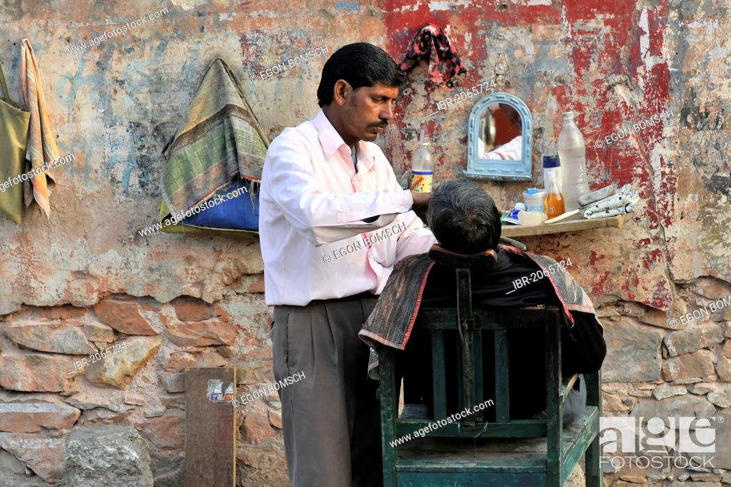 Stock Photo: Street barber shaving a man, town centre of Jaipur, Rajasthan, North India, South Asia, Asia.