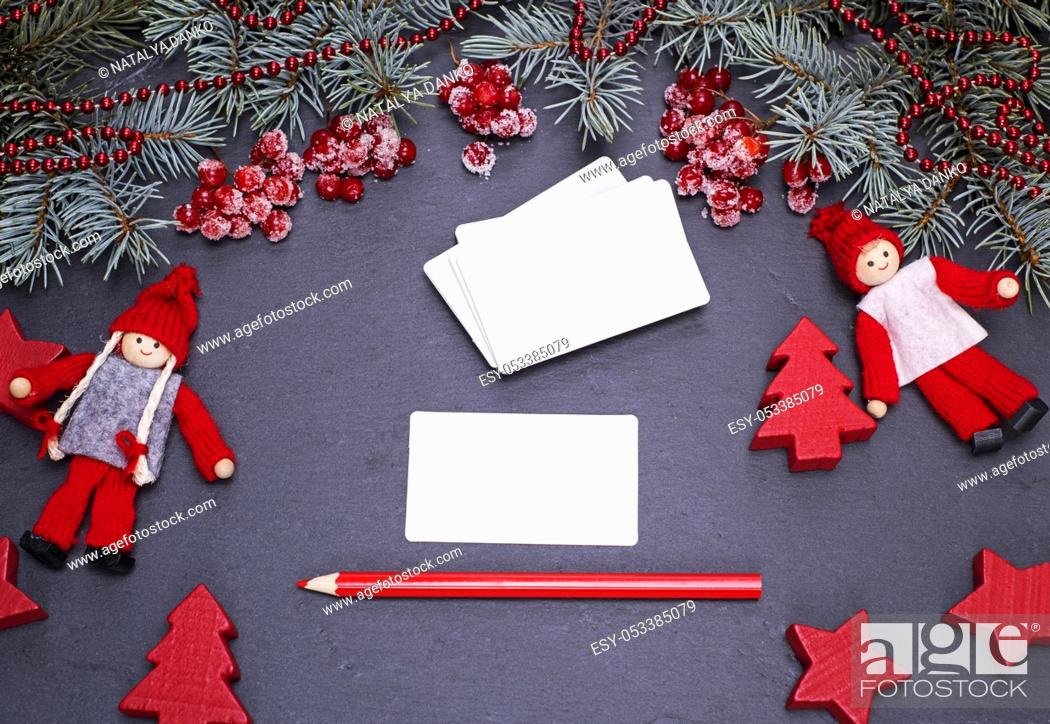 Stock Photo: blank white paper business cards on a black background and a red pencil, top view.