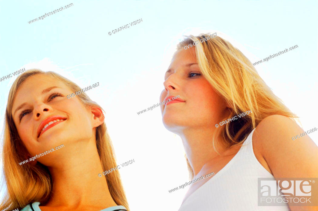 Stock Photo: Two young women standing outdoors.